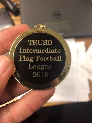 TRUSD district medal for Flag Football Team